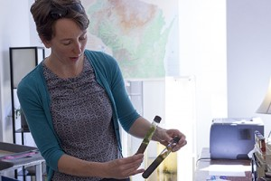 Geology Museum's Brooke Norsted with home-grown microbes. (Sarah Morton, College of Letters & Science)