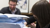 """""""You see it in the blue books, if you wrote questions poorly,"""" says Assistant Professor of Communication Arts Eric Hoyt, pictured with teaching assistant Olivia Conti. """"You wonder, why did I make them go through this?"""" (Sarah Morton, College of Letters & Science)"""