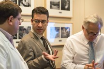 Assistant Professor of Computer Sciences Eftychios Sifakis, center, talks with Dr. Tim King, left, and Dr. Court Cutting during a training session for UW-Madison surgical residents. (Photos by Sarah Morton, College of Letters & Science)