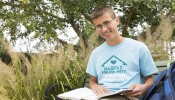 """""""When I get to a really difficult problem, it helps to look up from the page and see something beautiful in nature,"""" says Math Talent Search winner Thomas Hameister, who enjoys studying outdoors in the Allen Centennial Gardens. (Photo by Sarah Morton, College of Letters & Science)"""