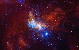 Correlating X-ray emissions from Sagittarius A, a massive black hole at the center of the Milky Way shown above, with IceCube Neutrino Observatory data, UW-Madison researchers have seen hints that the black hole is emitting neutrinos. (Image courtesy NASA)