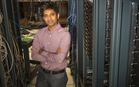 """""""I want to make networks perform well and be robust, even as new, disruptive technologies arise, including both hardware and software,"""" says Associate Professor of Computer Sciences Aditya Akella. (Photo by Andy Manis)"""