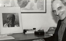 Jan Vansina sits at his desk in 1986. (Photo courtesy UW-Madison Archives)