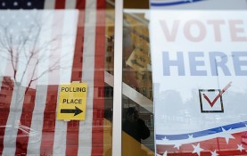Polling place signage posted in a window at the University Square complex in 2012. (Photo by Jeff Miller, University Communications)