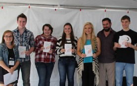 Laura Schmitt, left, with Green Bay writers participating at the Artstreet literary stage. Schmitt created The Quill — a new literary journal for middle and high school students in Green Bay. (Photo by Dave Lassen, Morgridge Center for Public Service)
