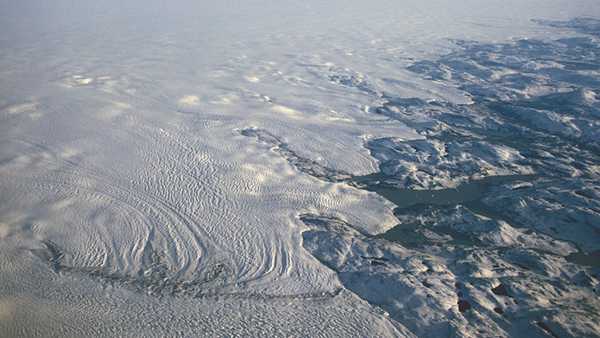 A new study shows clouds are playing a larger role in heating the Greenland Ice Sheet than scientists previously believed, raising its temperature by 2 to 3 degrees compared to cloudless skies and accounting for as much as 30 percent of the ice sheet melt. (Photo by Hannes Grobe)