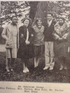 This image shows Mr. and Mrs. John Barton with two African American women, Floria Pinkney and Wenonah Bond studying at the International People's College in Elsinore, Denmark in 1930. The Bartons taught at the school. They left before Denmark was invaded during World War II and John Barton taught at UW-Madison for 25 years until he retired in 1962.